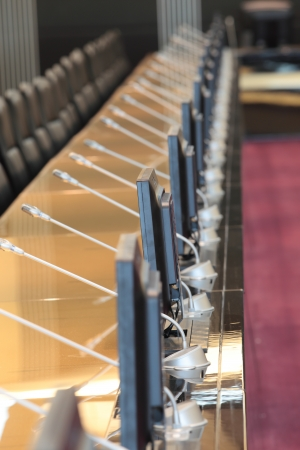 before a conference, the microphones in front of empty chairs Stock Photo - 20959500