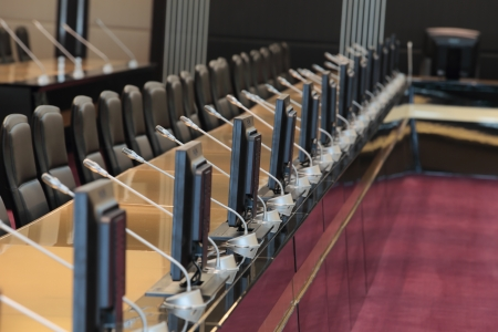 before a conference, the microphones in front of empty chairs Stock Photo - 20959501