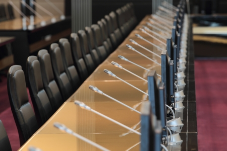 before a conference, the microphones in front of empty chairs Stock Photo - 20959502