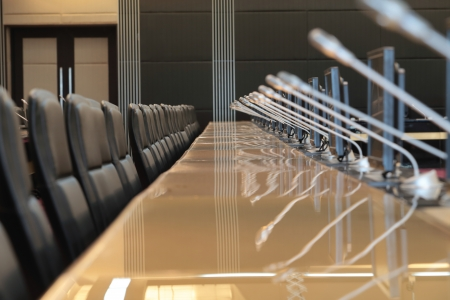 before a conference, the microphones in front of empty chairs Stock Photo - 20959504