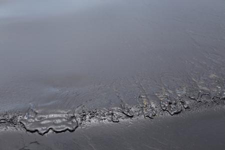 crude oil spill on the beach