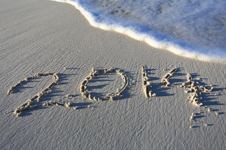 Year 2014 written in sand, on tropical beach Stock Photo - 23939990