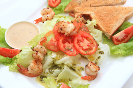 Green salad with shrimps - healthy eating concept photo