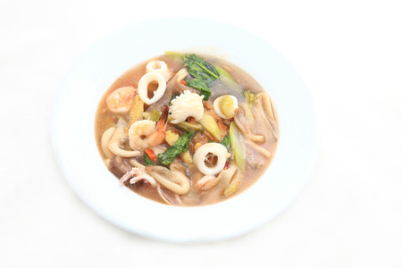 Fried noodle with pork and seafood soaked photo