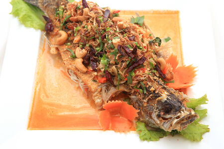 Fried snapper with chili sauce on the plate photo