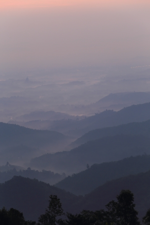 Hills on a colorful misty morning in Chiang Rai,Thailand photo