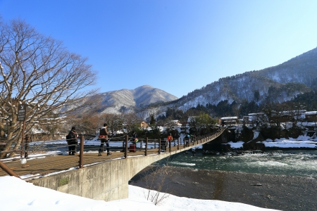 gassho zukuri: SHIRAKAWA, JAPAN - JANUARY 18  Tourists visit old village on JANUARY 18, 2014 in Shirakawa-go, Japan  Shirakawa is one of most popular attractions in Japan, listed as UNESCO World Heritage Site since 1995