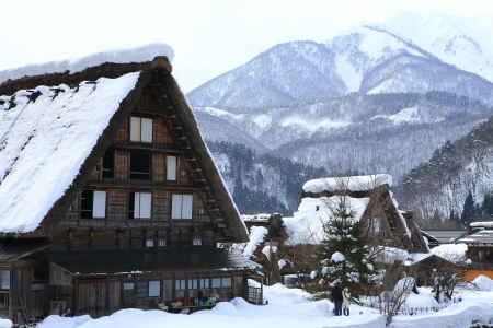 gokayama: SHIRAKAWA, JAPAN - JANUARY 18  Tourists visit old village on JANUARY 18, 2014 in Shirakawa-go, Japan  Shirakawa is one of most popular attractions in Japan, listed as UNESCO World Heritage Site since 1995