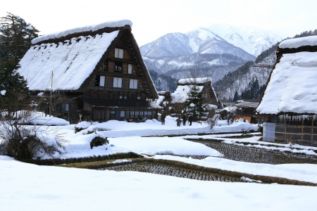 SHIRAKAWA, JAPAN - JANUARY 18  Tourists visit old village on JANUARY 18, 2014 in Shirakawa-go, Japan  Shirakawa is one of most popular attractions in Japan, listed as UNESCO World Heritage Site since 1995
