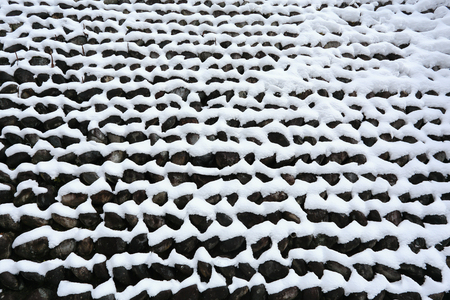 stone wall covered with snow in sub-zero temperatures photo