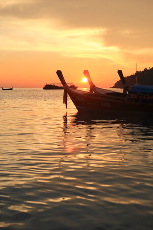 phangnga: long tail boats at sunset at Koh Lipe in Satun, Thailand Stock Photo
