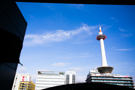 KYOTO, JAPAN - January 20, 2014: Tower and Kyoto Tower Hotel viewed from Kyoto station bus terminal .The tower was first opened to the public on December 28, 1964.