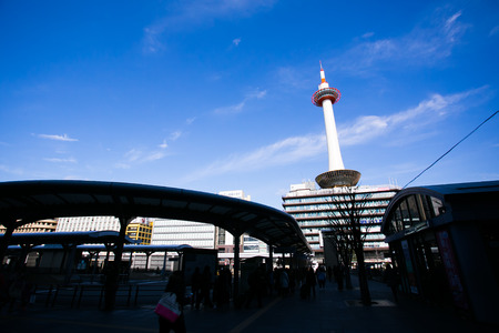 KYOTO, JAPAN - January 20, 2014  Tower and Kyoto Tower Hotel viewed from Kyoto station bus terminal  The tower was first opened to the public on December 28, 1964