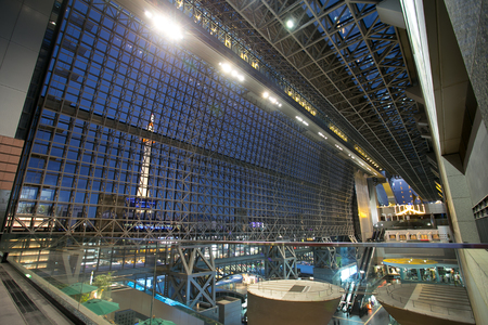 futurism: KYOTO, JAPAN - January 14, 2014: Kyoto Station is Japans 2nd largest train station and its futurism architecture opened amid controversy in 1997 in the otherwise historical city Editorial