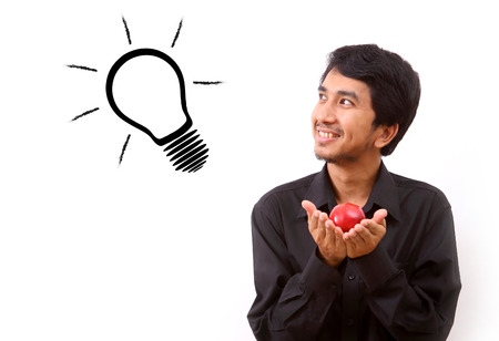 coming up with: Happy young man coming up with an idea or solution Stock Photo