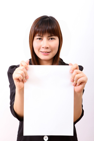 Showing sign woman  Woman showing empty blank paper sign board with copy space photo