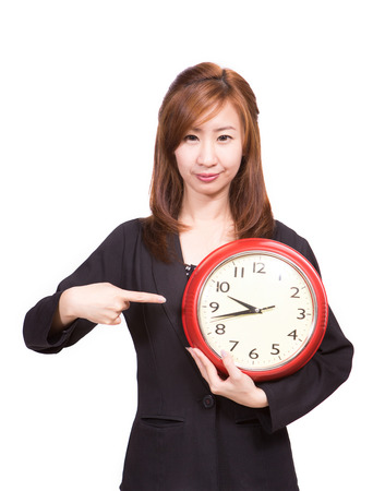 Woman with red alarm clock isolated on white photo