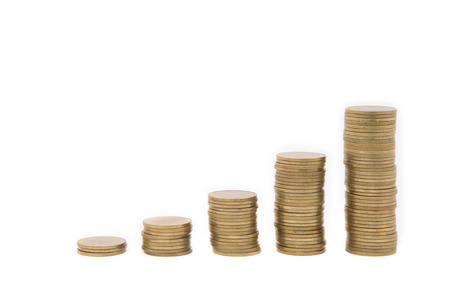 Coins in growth chart, isolated on white background. photo