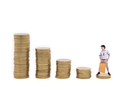 Shopping man goes up the gold coins on a white background photo