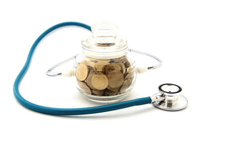 stethoscope with coins in the savings, financial concept photo