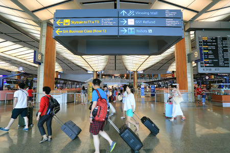 airport check in counter: SINGAPORE - MAY 13 : Check in counters at Changi International Airport on May 13, 2014 in Singapore. Changi Airport serves more than 100 airlines operating 6,100 weekly flights
