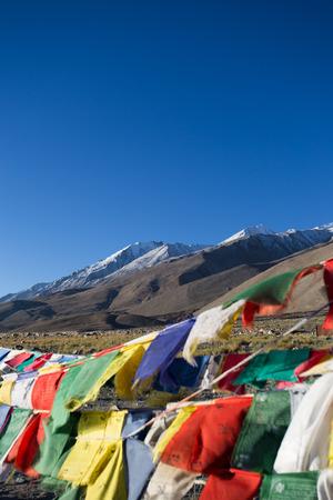 leah: Prayer flag on highest highway Khardungla pass , Leh Ladakh Stock Photo