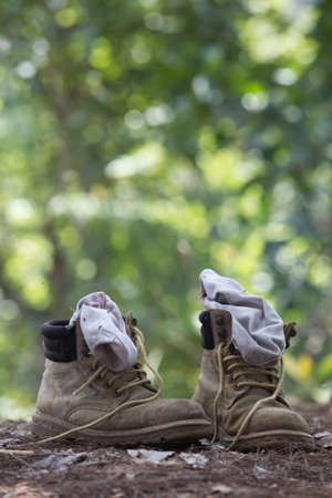 camping tent: touristic boots near a camp