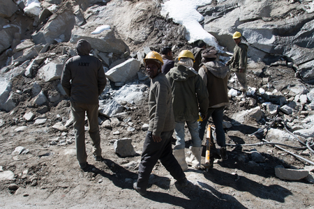 road conditions: KASHMIR, INDIA - SEPTEMBER 17: Unidentified road builders on Zoji La, Srinagar - Leh road, India, September 17, 2014. Zoji La is a Himalayan pass at elevation of 3,528 m. Its the most dangerous pass in Kashmir Editorial