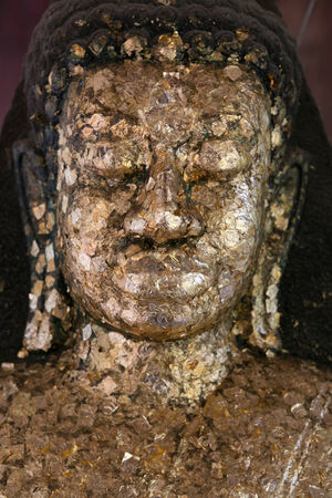 buddhism prayer belief: close up Buddha statue gilded in the measure