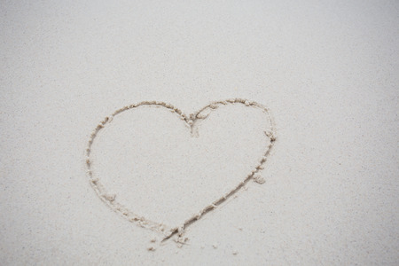 evoke: Heart drawn on sand
