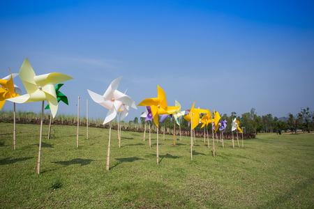 wind farm: Toy windmill concept of green energy wind farm in field