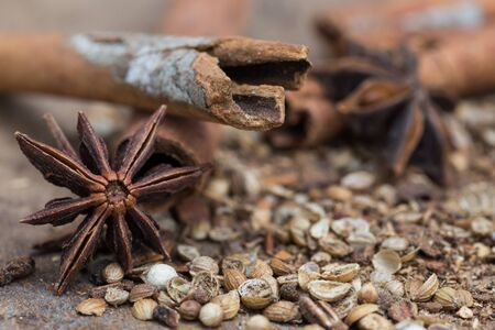 surface closeup: Spices lying on a wooden surface closeup
