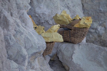 condensation basket: Baskets with sulphur at Kawah Ijen volcano crater, Java, Indonesia