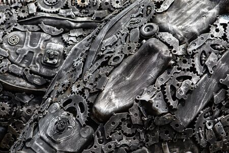 gearing: handicraft metal artwork from used spare parts background
