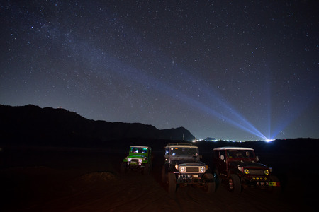 otherworldly: BROMO, INDONESIA - oct 12: Unidentified 4x4 Jeep for rent among the Milky way over the bromo volcano on october 12,2015 in Java, Indonesia. Mount Bromo is one of the most visited tourist attractions