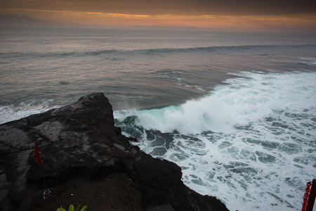 indo: Blue wave at sunset Bali Beach ,Indonesia