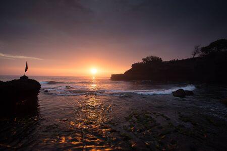 pura: sunset over hindu temple Pura Tanah Lot, Bali, Indonesia Stock Photo