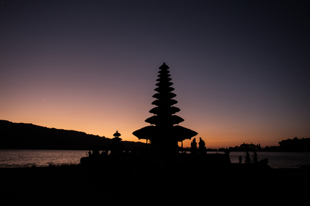 danu: Pura Ulun Danu temple silhouette before sunrise on a lake Bratan. Bali, Indonesia