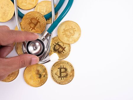 Cryptocurrency medical concept with a gold bitcoin coin