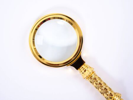 Small Gold Magnifying Glass Isolated on a White Background