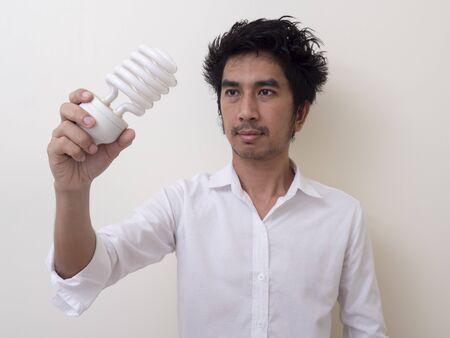 Man holding energy saving bulb for lamp