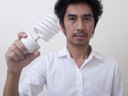 Man holding energy saving bulb for lamp Standard-Bild - 147038744