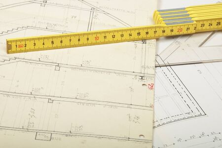 yard stick: architecture plan with corrections and yellow yard stick Stock Photo