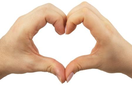 corazon en la mano: Manos en la forma de un coraz�n hechos por parejas masculinas femeninas