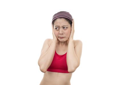 loud noise: Women blocking out loud noise from ears