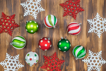 color: Luxury and  shiny Christmas ball with  snowflakes on wooden background