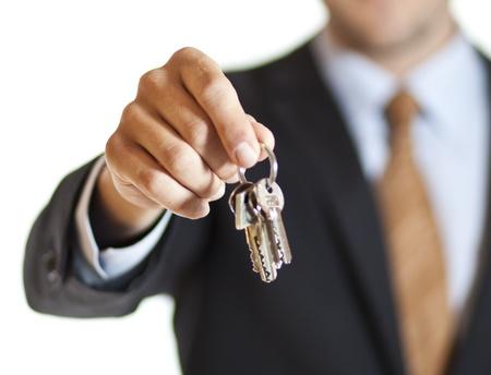 Businessman handing you the keys photo