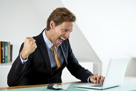 enthusiastic: A succesfull businessman celebrating a business deal