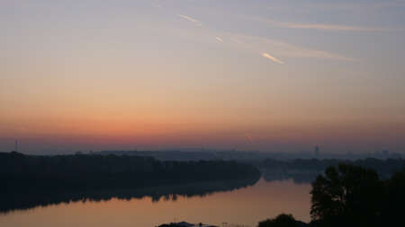Sunrise Timelape on Danube River in Belgrade Serbia, Red and Orange Sky with Nature in the Landscape.