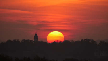 Close View of Sunrise Timelapse with Church Silhouette in Belgrade, Serbia. Dramatic red sky over the Cathedral of St. Michael the Archangel Serbian Orthodox Cathedral Church (Saborna crkva) in Beograd Downtown. High quality 4k footage Stok Fotoğraf